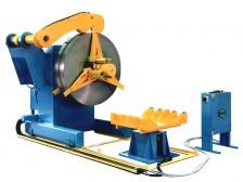 Wanzke A-PMS-Haspel zum Auf- und Abwickeln mit Coilladewagen (feststehend mit Hebe- und Senkfunktion), Haspelverfahreinrichtung und Andrückrolle (hydraulisch betätigt)